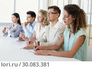 Купить «Casual business team listening during meeting», фото № 30083381, снято 16 января 2014 г. (c) Wavebreak Media / Фотобанк Лори