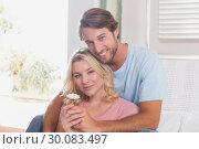 Купить «Happy couple relaxing on the couch», фото № 30083497, снято 24 января 2014 г. (c) Wavebreak Media / Фотобанк Лори