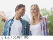 Купить «Hip young couple laughing together», фото № 30084105, снято 19 февраля 2014 г. (c) Wavebreak Media / Фотобанк Лори
