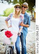 Купить «Hip young couple going for a bike ride», фото № 30084297, снято 19 февраля 2014 г. (c) Wavebreak Media / Фотобанк Лори