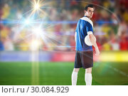Composite image of handsome football player in blue jersey. Стоковое фото, агентство Wavebreak Media / Фотобанк Лори