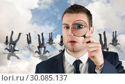 Купить «Composite image of businessman looking through magnifying glass», фото № 30085137, снято 11 июня 2014 г. (c) Wavebreak Media / Фотобанк Лори
