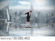 Купить «Composite image of businesswoman performing a balancing act on tightrope», фото № 30085453, снято 11 июня 2014 г. (c) Wavebreak Media / Фотобанк Лори