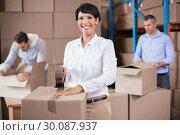Купить «Warehouse workers packing up boxes», фото № 30087937, снято 10 мая 2014 г. (c) Wavebreak Media / Фотобанк Лори