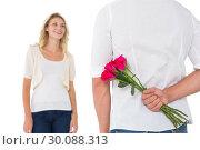 Man hiding bouquet of roses from woman. Стоковое фото, агентство Wavebreak Media / Фотобанк Лори