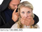 Купить «Theft covering young womans mouth», фото № 30088345, снято 29 апреля 2014 г. (c) Wavebreak Media / Фотобанк Лори