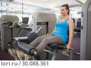 Купить «Fit brunette using weights machine for legs», фото № 30088361, снято 5 марта 2014 г. (c) Wavebreak Media / Фотобанк Лори