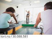 Купить «Spin class working out with motivational instructor», фото № 30088581, снято 5 марта 2014 г. (c) Wavebreak Media / Фотобанк Лори