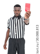 Купить «Serious referee showing red card», фото № 30088813, снято 24 апреля 2014 г. (c) Wavebreak Media / Фотобанк Лори