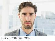 Купить «Businessman looking at the camera», фото № 30090285, снято 6 мая 2014 г. (c) Wavebreak Media / Фотобанк Лори