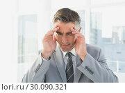 Купить «Businessman suffering from a headache», фото № 30090321, снято 6 мая 2014 г. (c) Wavebreak Media / Фотобанк Лори