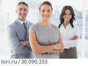 Купить «Businesswoman smiling with folded arms », фото № 30090333, снято 6 мая 2014 г. (c) Wavebreak Media / Фотобанк Лори