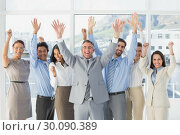 Купить «Cheering workers with raised arms», фото № 30090389, снято 6 мая 2014 г. (c) Wavebreak Media / Фотобанк Лори