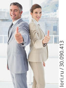 Купить «Employees giving a thumb's up», фото № 30090413, снято 6 мая 2014 г. (c) Wavebreak Media / Фотобанк Лори