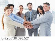 Купить «Business team stacking their hands», фото № 30090521, снято 6 мая 2014 г. (c) Wavebreak Media / Фотобанк Лори