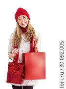 Купить «Pretty blonde holding shopping bags», фото № 30092005, снято 9 июля 2014 г. (c) Wavebreak Media / Фотобанк Лори