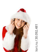 Купить «Festive redhead smiling at camera», фото № 30092481, снято 2 июля 2014 г. (c) Wavebreak Media / Фотобанк Лори