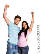 Купить «Young couple cheering at camera», фото № 30093149, снято 2 июля 2014 г. (c) Wavebreak Media / Фотобанк Лори
