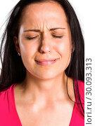 Купить «Sad young brunette crying in close up», фото № 30093313, снято 2 июля 2014 г. (c) Wavebreak Media / Фотобанк Лори