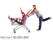 Купить «Man pushing woman in trolley», фото № 30093493, снято 4 июля 2014 г. (c) Wavebreak Media / Фотобанк Лори