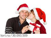 Купить «Couple holding a christmas gift», фото № 30093509, снято 4 июля 2014 г. (c) Wavebreak Media / Фотобанк Лори
