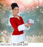 Купить «Composite image of pretty santa girl holding gift», фото № 30094289, снято 26 августа 2014 г. (c) Wavebreak Media / Фотобанк Лори