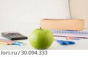 Купить «Students table with school supplies», фото № 30094333, снято 17 июля 2014 г. (c) Wavebreak Media / Фотобанк Лори