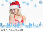 Купить «Composite image of young woman wearing santa hat», фото № 30095881, снято 29 августа 2014 г. (c) Wavebreak Media / Фотобанк Лори