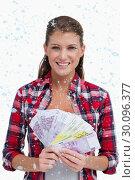 Купить «Composite image of portrait of a woman holding bank notes», фото № 30096377, снято 29 августа 2014 г. (c) Wavebreak Media / Фотобанк Лори
