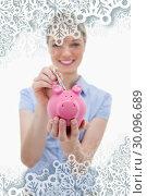 Купить «Composite image of note being put into piggy bank by woman», фото № 30096689, снято 29 августа 2014 г. (c) Wavebreak Media / Фотобанк Лори