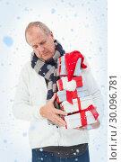 Купить «Composite image of mature man in winter clothes holding gifts», фото № 30096781, снято 29 августа 2014 г. (c) Wavebreak Media / Фотобанк Лори