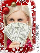 Купить «Composite image of blonde hiding her face with dollars banknotes», фото № 30096805, снято 29 августа 2014 г. (c) Wavebreak Media / Фотобанк Лори