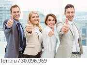 Купить «Business people gesturing thumbs up in office», фото № 30096969, снято 8 мая 2014 г. (c) Wavebreak Media / Фотобанк Лори