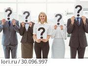 Купить «Business people holding question mark signs in office», фото № 30096997, снято 8 мая 2014 г. (c) Wavebreak Media / Фотобанк Лори