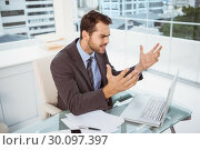 Купить «Frustrated businessman using laptop in office», фото № 30097397, снято 8 мая 2014 г. (c) Wavebreak Media / Фотобанк Лори