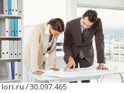 Купить «Colleagues working on blueprints at office», фото № 30097465, снято 8 мая 2014 г. (c) Wavebreak Media / Фотобанк Лори