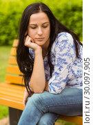 Купить «Thoughtful casual brunette sitting on bench», фото № 30097905, снято 20 июня 2014 г. (c) Wavebreak Media / Фотобанк Лори