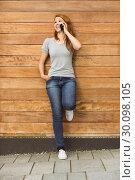 Купить «Pretty woman smiling while on a phone call», фото № 30098105, снято 13 июня 2014 г. (c) Wavebreak Media / Фотобанк Лори