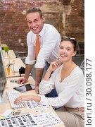 Купить «Smiling photo editors in office», фото № 30098177, снято 18 июня 2014 г. (c) Wavebreak Media / Фотобанк Лори