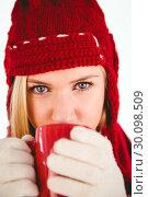 Купить «Festive blonde drinking from mug», фото № 30098509, снято 18 июля 2014 г. (c) Wavebreak Media / Фотобанк Лори