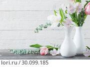 Купить «spring flowers in white vase», фото № 30099185, снято 12 февраля 2019 г. (c) Майя Крученкова / Фотобанк Лори