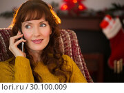Купить «Cheerful redhead on the phone at christmas», фото № 30100009, снято 3 октября 2014 г. (c) Wavebreak Media / Фотобанк Лори