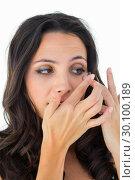 Купить «Pretty brunette putting in contact lens», фото № 30100189, снято 2 октября 2014 г. (c) Wavebreak Media / Фотобанк Лори