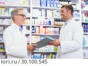 Купить «Smiling team of pharmacists holding clipboard», фото № 30100545, снято 13 сентября 2014 г. (c) Wavebreak Media / Фотобанк Лори