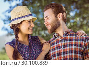 Купить «Hipster couple smiling at each other», фото № 30100889, снято 19 ноября 2014 г. (c) Wavebreak Media / Фотобанк Лори