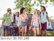 Купить «Young friends arriving at their campsite», фото № 30101249, снято 19 ноября 2014 г. (c) Wavebreak Media / Фотобанк Лори