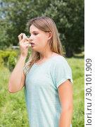 Купить «Pretty blonde using an asthma inhaler», фото № 30101909, снято 11 ноября 2014 г. (c) Wavebreak Media / Фотобанк Лори