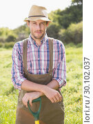 Купить «Happy farmer smiling at camera», фото № 30102037, снято 11 ноября 2014 г. (c) Wavebreak Media / Фотобанк Лори
