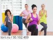 Women practicing kickboxing at fitness studio. Стоковое фото, агентство Wavebreak Media / Фотобанк Лори