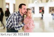 Купить «Male and small daughter looking pictorial art in halls», фото № 30103693, снято 19 марта 2019 г. (c) Яков Филимонов / Фотобанк Лори
